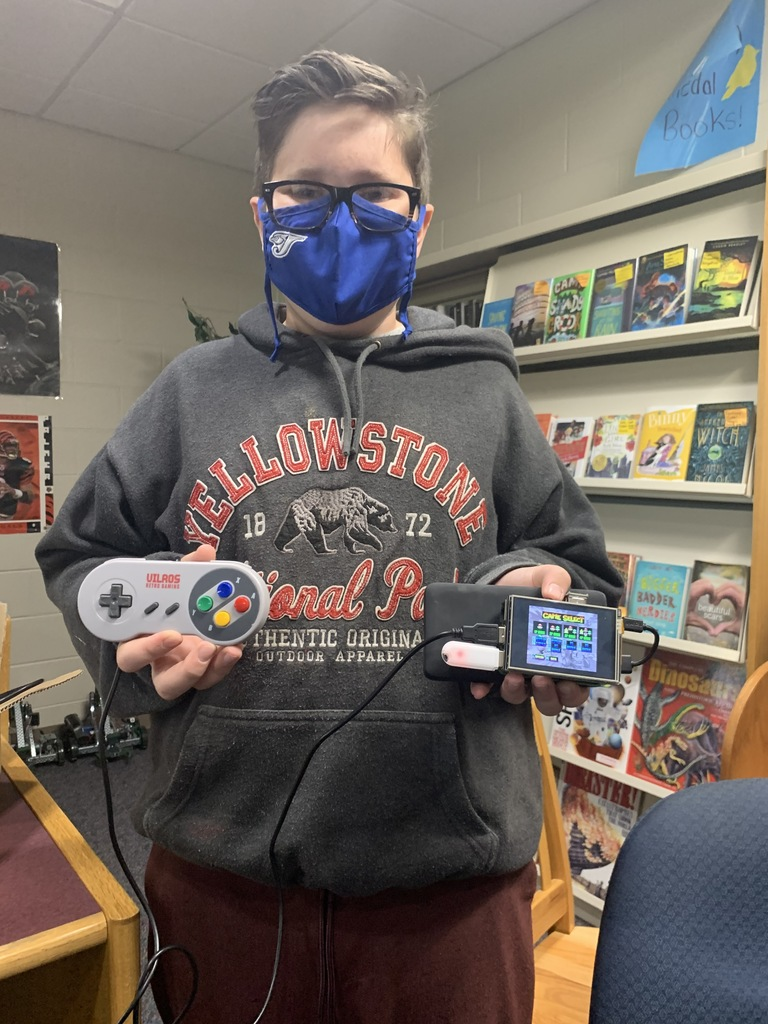 Advanced Tech Student Judah with Portable Gaming Console