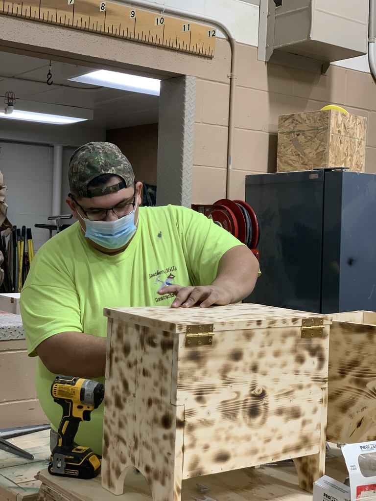 Xavier working on boxes in construction