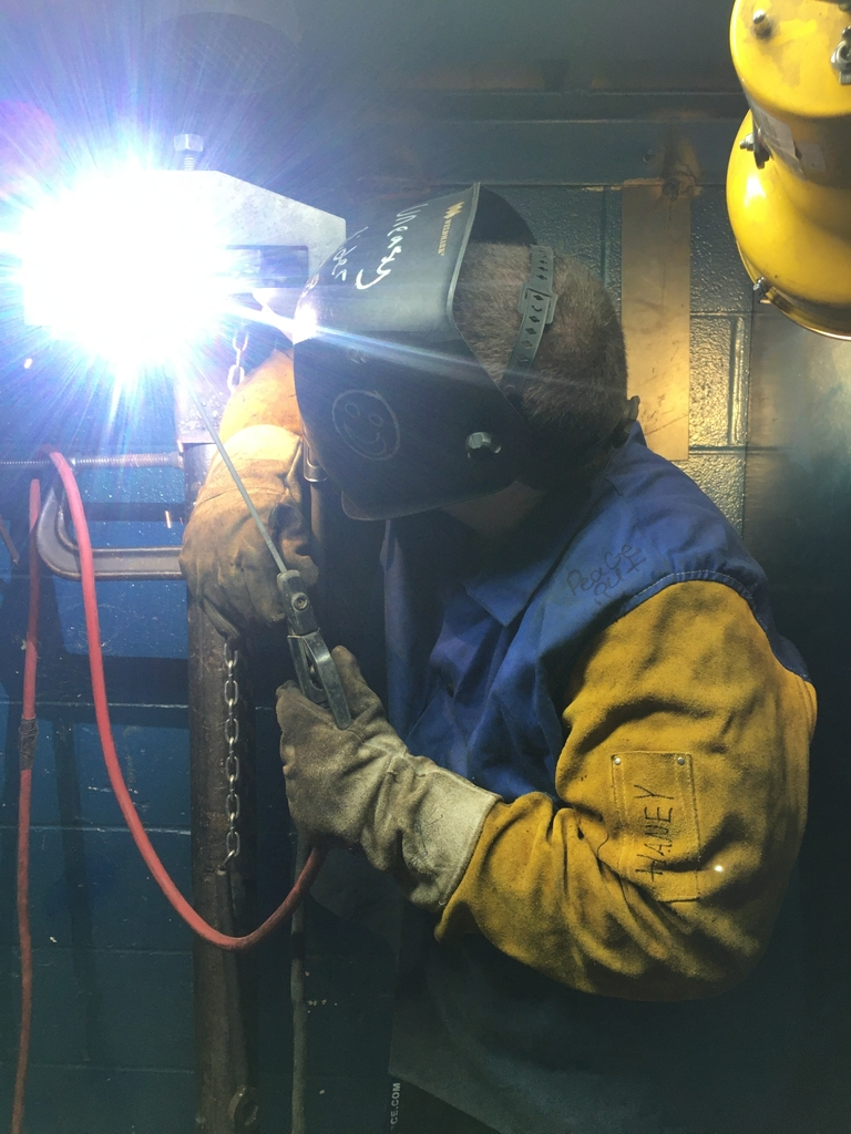 Senior welders practicing for the overhead certification test -Mason Caldwell senior welder