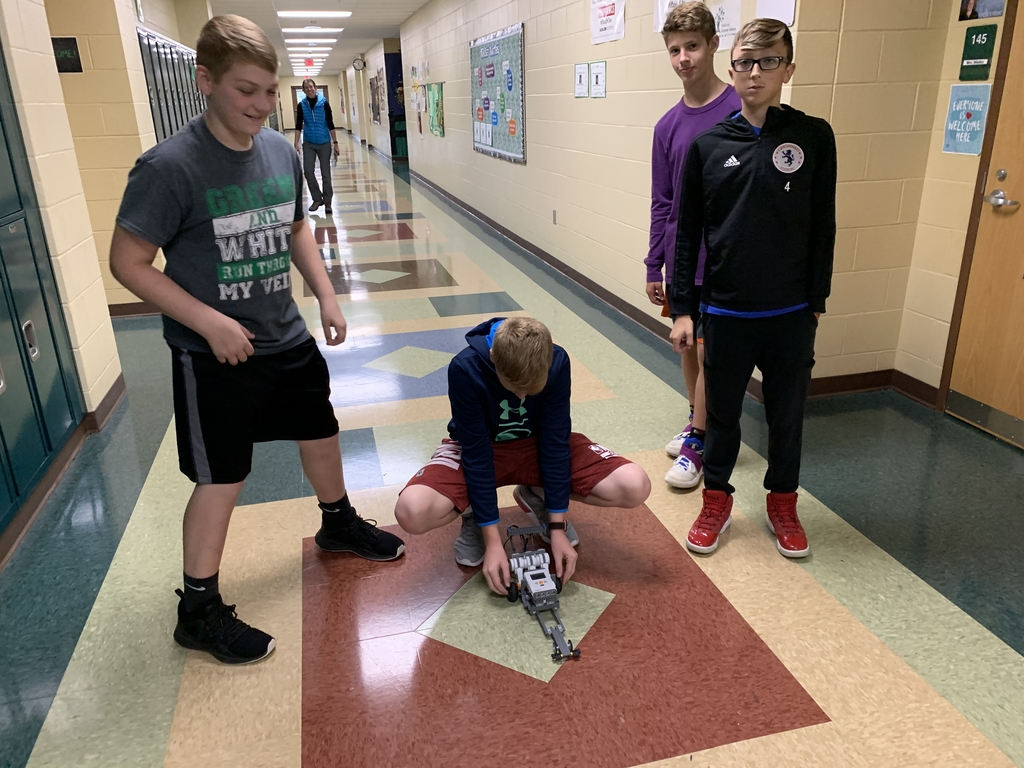 "Students testing their ""dragster"" robot built with Lego Mindstorms."