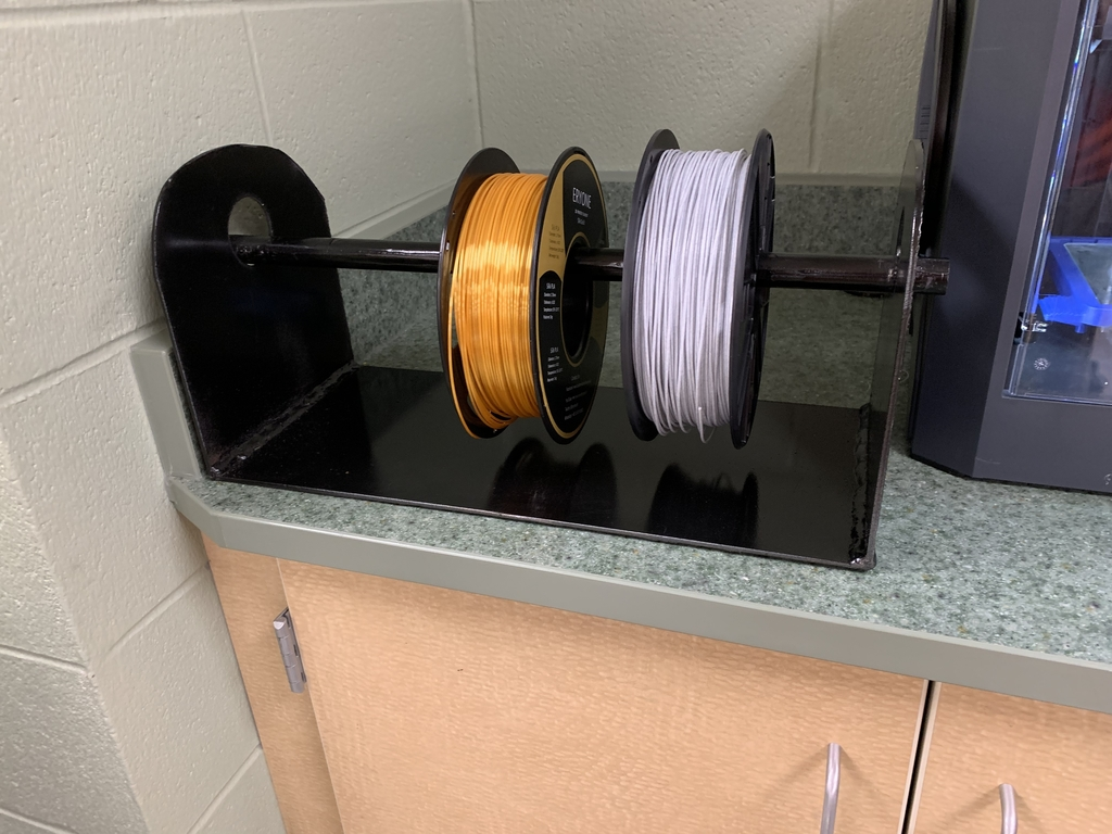 Filament holder custom designed by the CAD 2 class.
