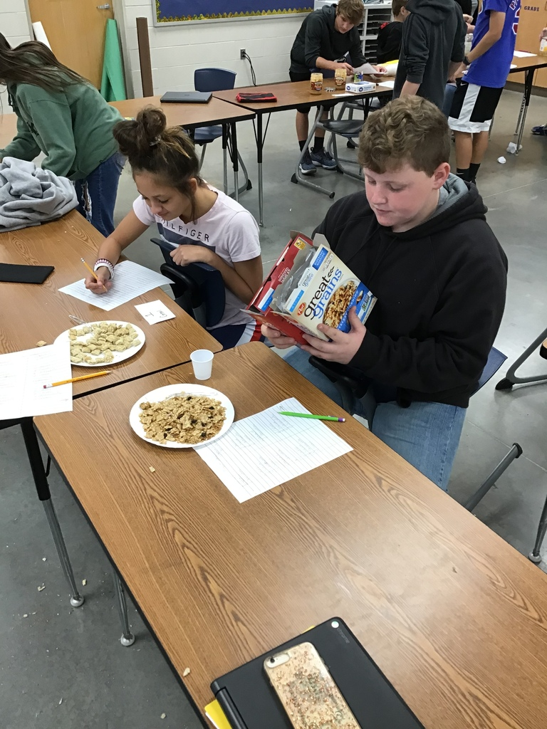 Students comparing GMO and non-GMO food items.