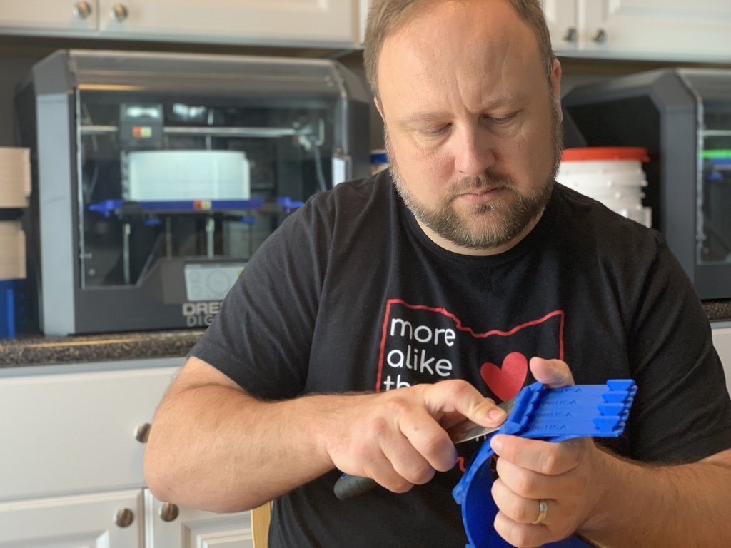 Jason Basford separating 3d printed parts.